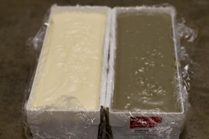 Molds filled with raw soap.