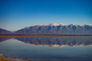 A view of Salt Lake City and the Wasatch Mountains from Antelope Island across Gunnison Bay of the Great Salt Lake.