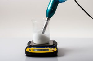 After heating, using an immersion blender to mix