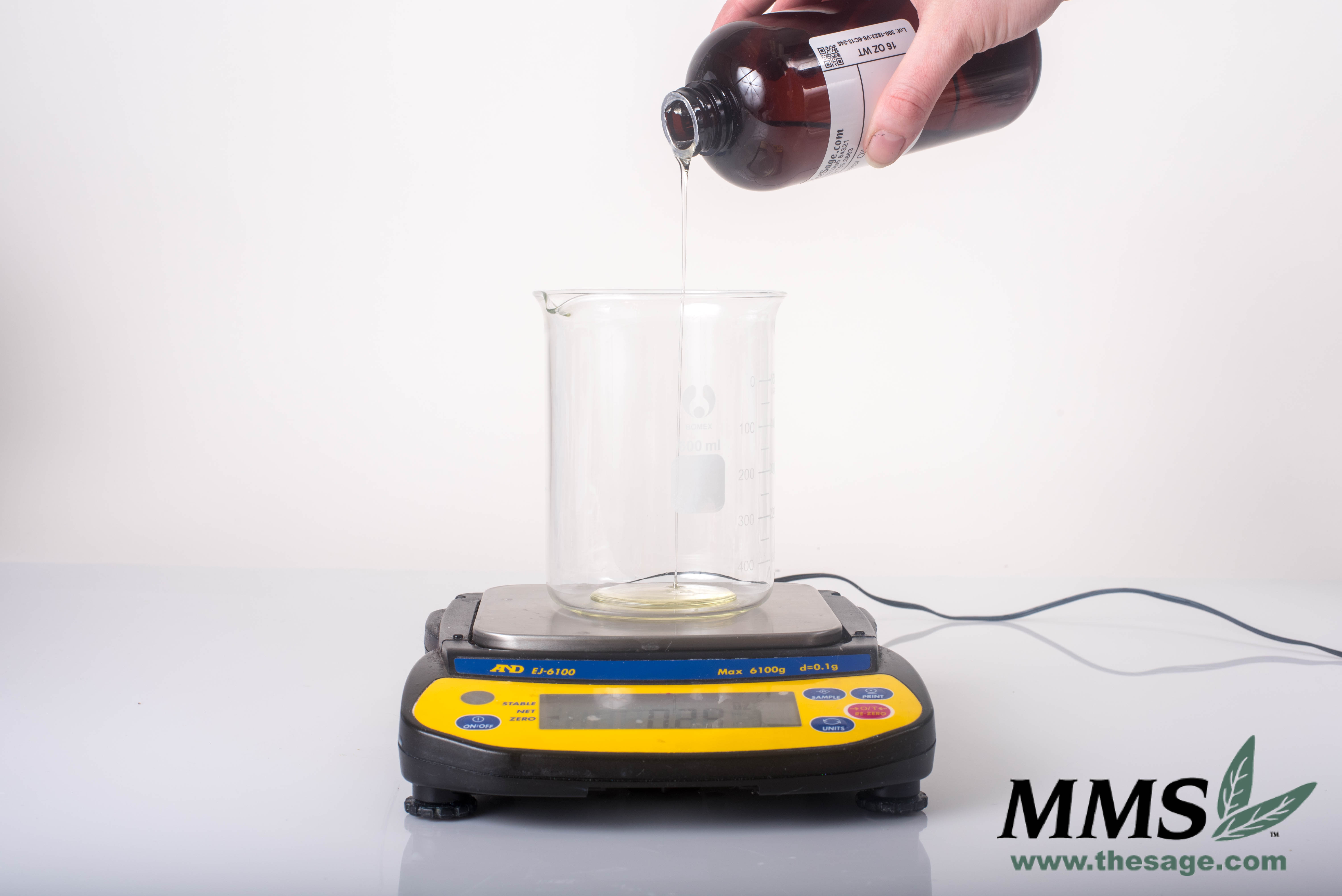 Pouring the Castor Oil in to my microwave safe beaker.