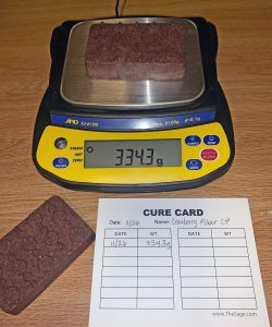 Soap being weighed with cure card.