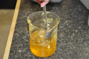 Stirring the mixture to melt the Lanolin.