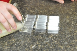 Filling tins.