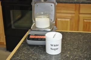 Weigh the white sugar.