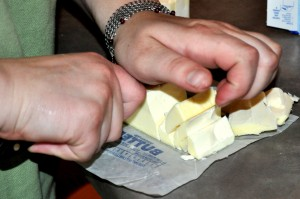 Cutting the cold butter.
