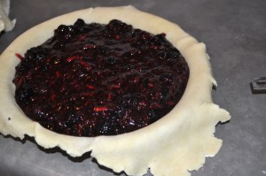 Filling in the chilled pie crust.