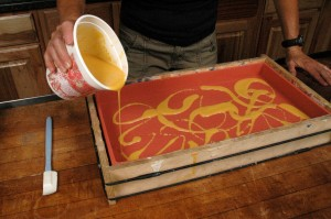 More swirls of yellow soap being made.
