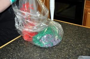 Placing shreds into a plastic bag.