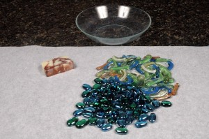 The bowl, marbles, and soap.