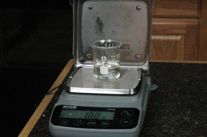 Weighing the Liquid Germall Plus and Freesia Fragrance Oil.