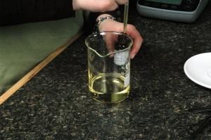 Adding Bourbon Geranium Essential to melted oils.