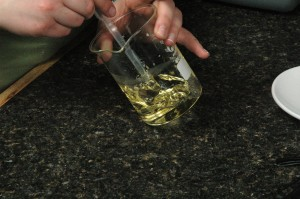 Stirring the oils together.
