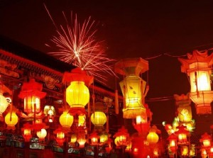 Fireworks behind a display of various lanterns