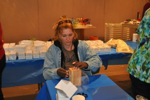 Shonna as she folds liners for the soap mold boxes.