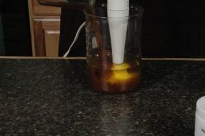 Adding lye solution to oils.